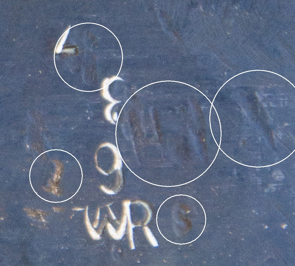 "circles identify other markings. Between the 3 and the 7 might be a 1. To the right of the three is a H, but it might be an FH or something in addition to the H. Ro the right of that is either a machining mark or some other symbol. The lower left circle appears to be a 1, and the lower right circle is clearly an ""s"""