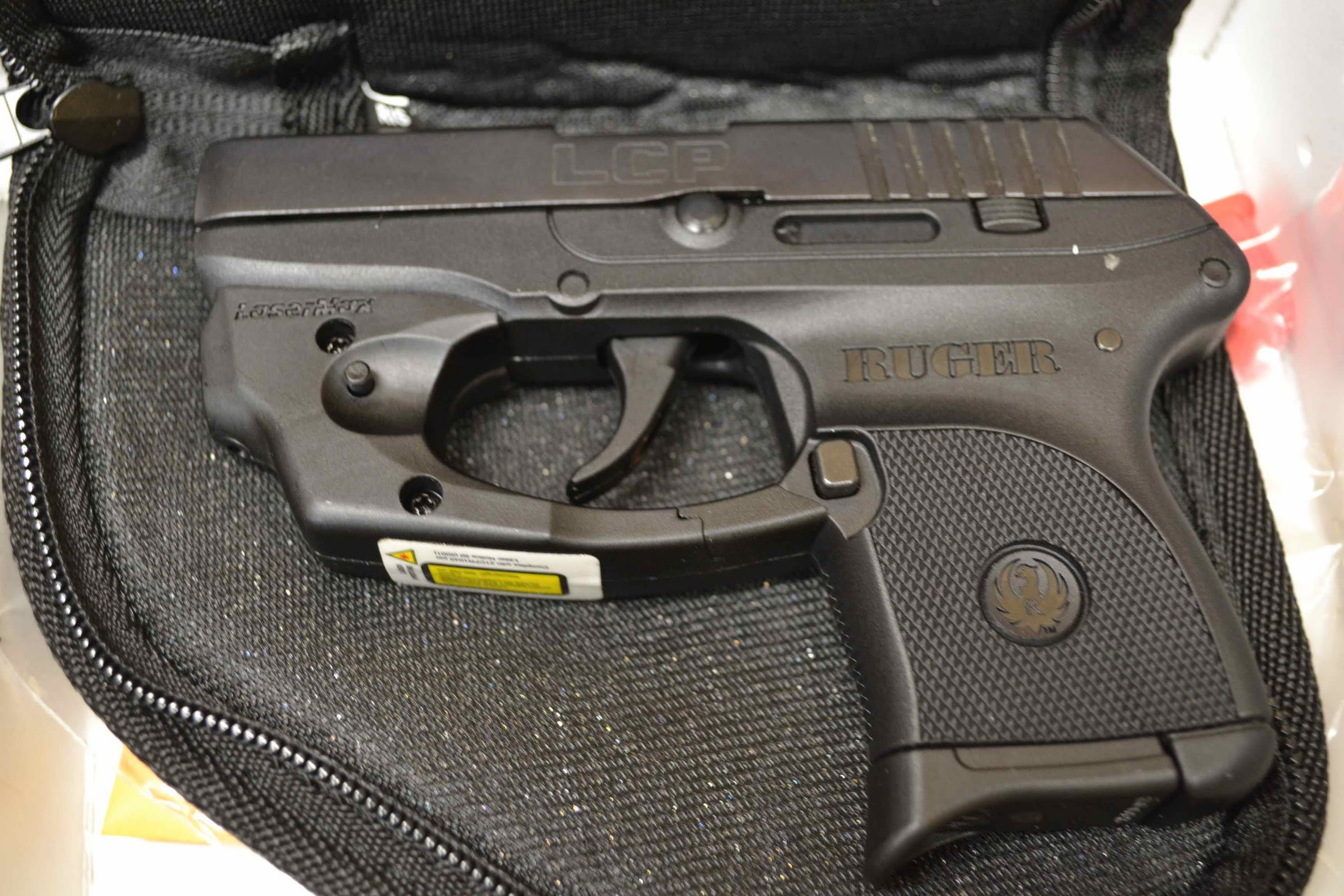 Ruger Lcp 380 Acp With Lasermax Laser And Pistol Pouch New In Box