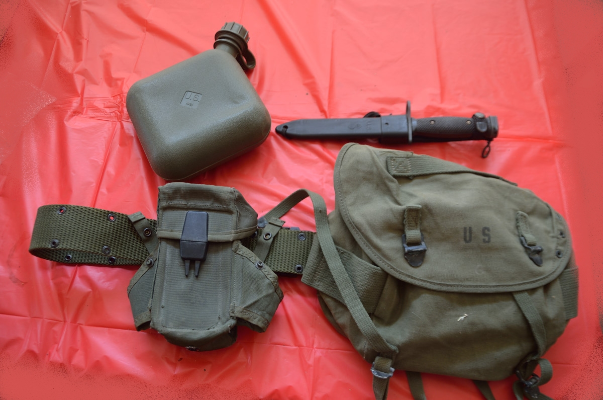 Post-WWII web belt, canteen, bayonet, mag/grenade pouch, and field bag