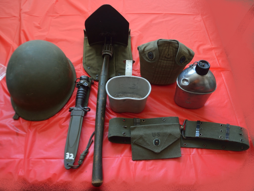 WWII soldier's equipment, pot helmet, shovel, bayonet, web belt, pouch, and canteen